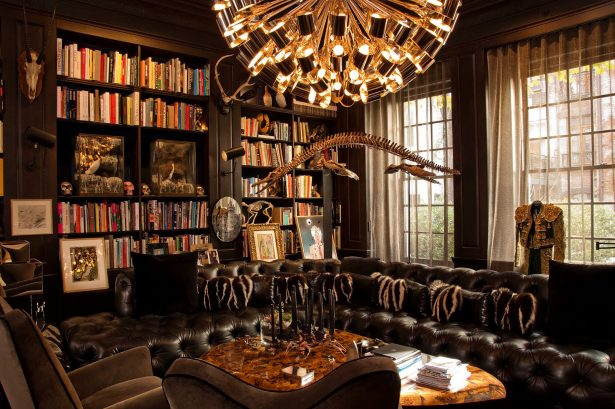 vintage-custom-home-library-design-amazing-gold-chandelier-leather-sofa-615x409